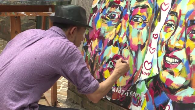 vietnam artist tran lam binh paints love on his portrait of us president donald trump and north korean leader kim jong unpart of his paintings for... - north vietnam stock videos & royalty-free footage