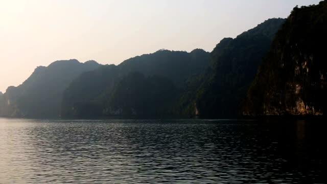 vietnam halong bay landscape at dawn hd pan left - halong bay stock videos and b-roll footage