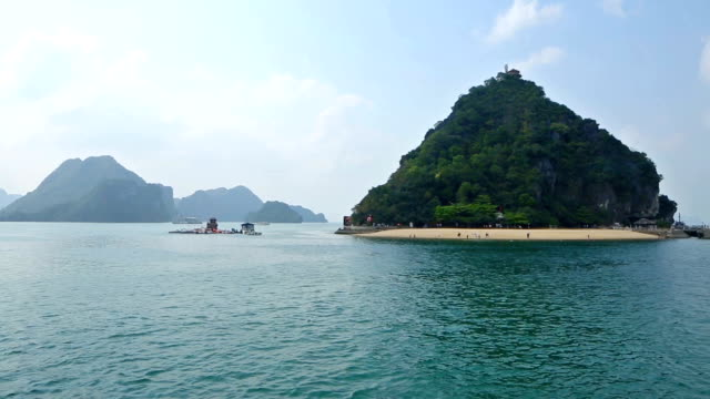 Vietnam Halong Bay landscape HD pan left with moored tourist boats