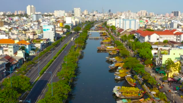 vietnam, ho chi minh city - the binh dong wharf floating market in tau hu canal in hcm city district 8, 4k high quality aerial view - vendor stock videos & royalty-free footage