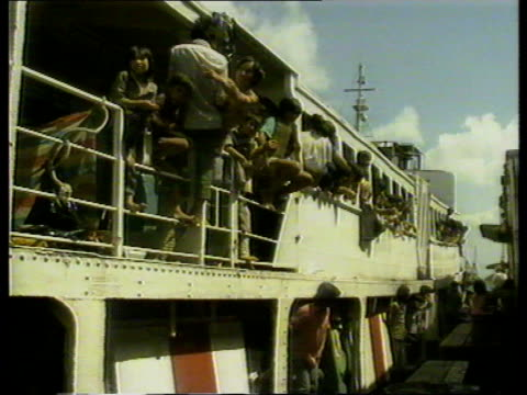 vietnam refugees nao boat load of vietnamese refugees shadowed by police launch refugees off ship children and adults in detention y f hui hong kong... - police boat stock videos and b-roll footage