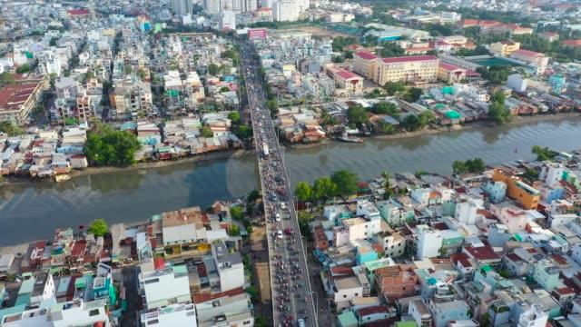 vietnam rush hour traffic jam on the bridge - ホーチミン市点の映像素材/bロール