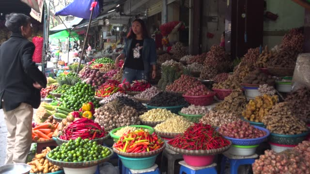 vietnam spices street market stall at thien thuat during tet. woman selling at a store - street market stock videos & royalty-free footage