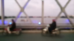 Vietnam traveling on scooters over the bridge