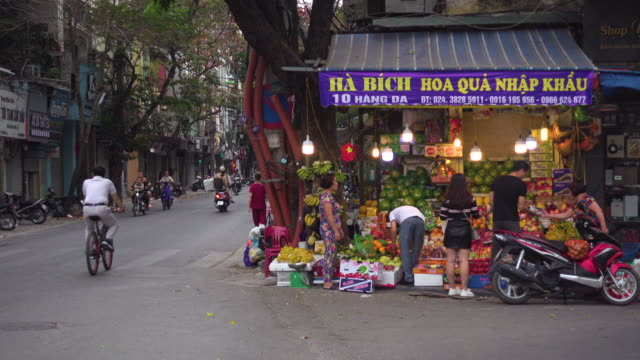 vietnam vegetables shop at hanoi street. people buying - market stall stock videos & royalty-free footage