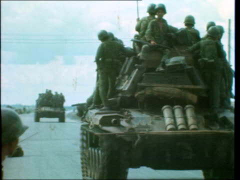 push forward:; south vietnam: highway 13: 12 miles from anloc: ext arvn convoy - half tracks - troops wave: - column of arvn walk towards - local... - howitzer stock videos & royalty-free footage