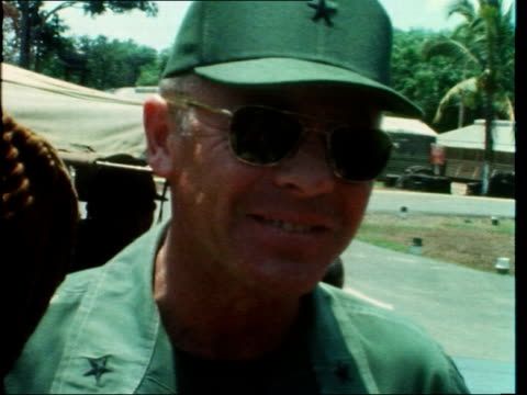 lorry and helicopter on highway 13:; south vietnam: highway 13: ext convoy towards lights on: troops on top lorry: lorry r-l: another r-l: helicopter... - vietnam war stock videos & royalty-free footage