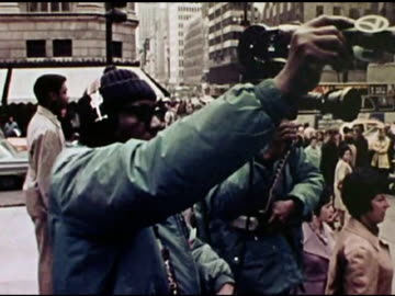 / vietnam war protesters outside rockefeller center singing, 'give peace a chance' as abc news film crews film them. - 1972 stock videos & royalty-free footage
