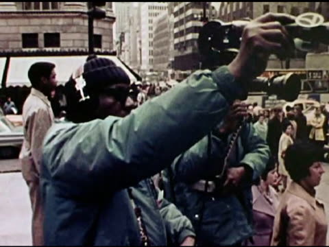 / vietnam war protesters outside rockefeller center singing 'give peace a chance' as abc news film crews film them - fernsehserie stock-videos und b-roll-filmmaterial