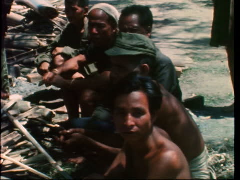 wounded arvn and civilians arrive in kontum:; south vietnam: kontum: ext air view explosion in jungle: wounded arvn walk at rear of helicopter also... - vietnam war stock videos & royalty-free footage