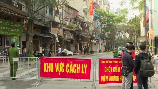 vietnamese authorities put a section of hanoi's truc bach street under quarantine after a vietnamese woman living in the area tested positive for... - north vietnam stock videos & royalty-free footage