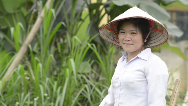 vietnamese farmer smiling into camera - south east asian ethnicity stock videos & royalty-free footage