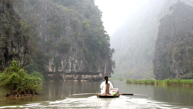Vietnamese female rowing using her legs Tam Coc nr Ninh Binh nr Hanoi