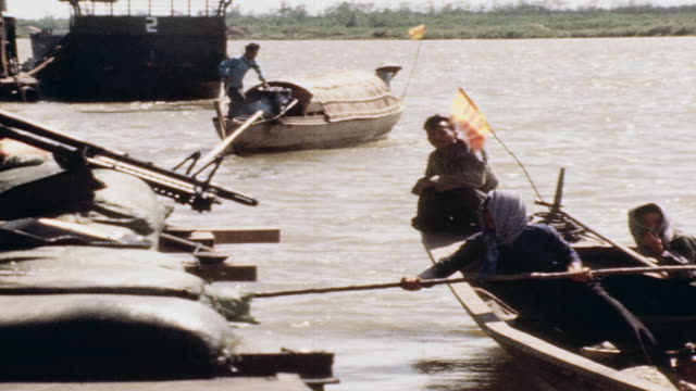 vietnamese fishermen in sampans rowing away from mobile base in river / vietnam - sampan stock videos & royalty-free footage