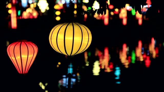 vietnamese illuminated lamps in market at night, hoi an, vietnam - traditionally vietnamese stock videos & royalty-free footage