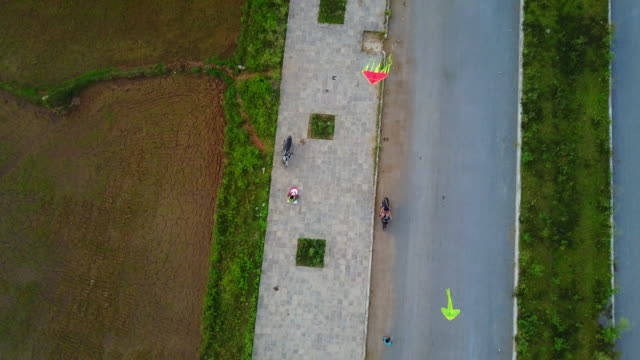 vietnamese kids fly kites at sunset in phong nha. - kite toy stock videos and b-roll footage