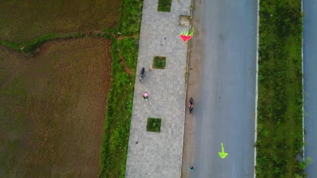 Vietnamese kids fly kites at sunset in Phong Nha.
