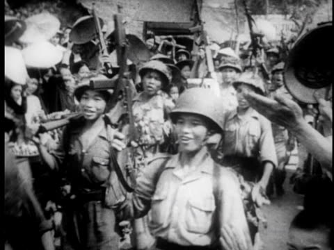 stockvideo's en b-roll-footage met vietnamese medics care for wounded french soldier / food is given to prisoners / prisoners are marched down road - strohoed