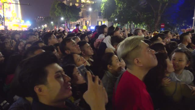 vietnamese people celebrating tet at hanoi fireworks. taking pictures with smart phones. hanoi hoan kiem old quarter district - chinese culture stock videos & royalty-free footage