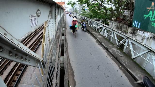 vietnamese people driving across long bien bridge hanoi - bridge built structure stock videos & royalty-free footage
