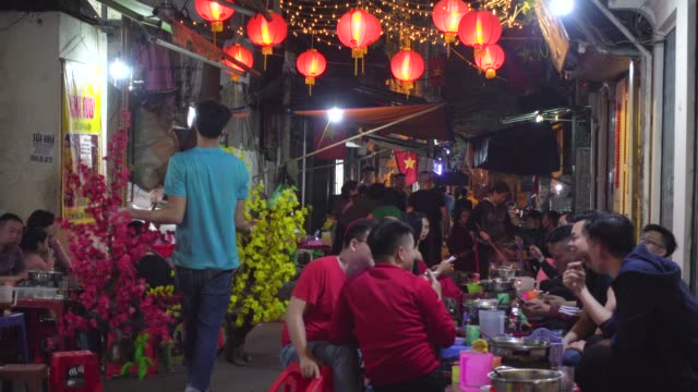 vietnamese people meeting at a restaurant during tet celebration. hanoi old quarter at night. hoan kiem old town district - traditionally vietnamese stock videos & royalty-free footage