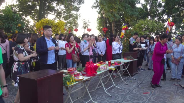 Vietnamese people praying during Tet. Tran Quoc Buddhist Pagoda temple at Hanoi