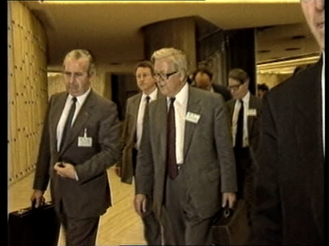 Vietnamese refugees ITN LIB SWITZERLAND Geneva UN HQ MS Sir Geoffrey Howe MP others along corridor to meeting on refugee problem EXT MS Large banner...