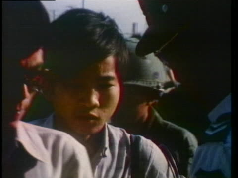 vietnamese soldiers check people's identification cards. - (war or terrorism or election or government or illness or news event or speech or politics or politician or conflict or military or extreme weather or business or economy) and not usa stock videos & royalty-free footage