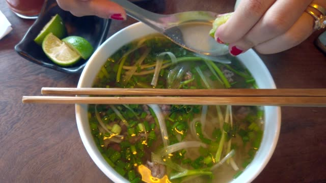 vietnamese soup pho bo - esotismo video stock e b–roll