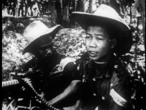 vietnamese troops moving through the jungle taking positions and firing weapons / taking prisoners - strohhut stock-videos und b-roll-filmmaterial