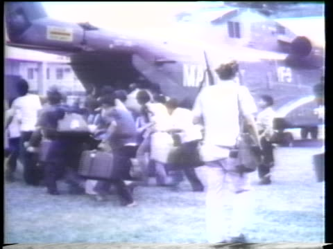 vietnamese walk through the streets in saigon while us military troops land in helicopters in 1975. - (war or terrorism or election or government or illness or news event or speech or politics or politician or conflict or military or extreme weather or business or economy) and not usa stock videos & royalty-free footage
