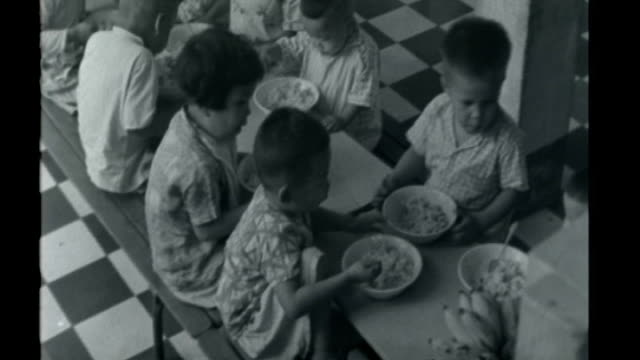 Vietnamese war orphan returns to Vietnam to set up orphanage X07076501 / ITN Reports 7 July 1965 Saigon Various views of Vietnamese orphans in yard...