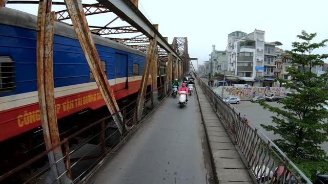 vietnamese workers crossing the long bien bridge hanoi - bridge built structure stock videos & royalty-free footage