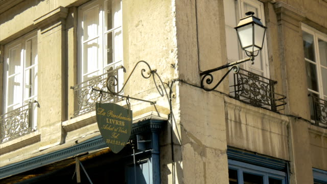 vieux lyon,shop sign,building frontage,zo - shop sign stock videos & royalty-free footage
