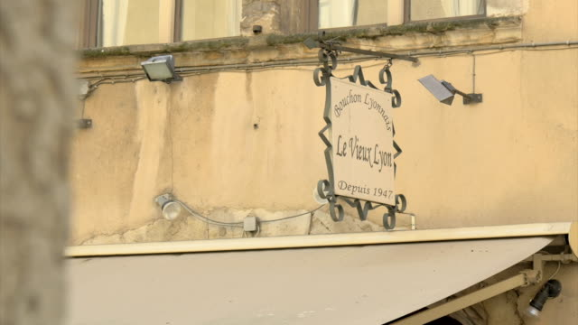 vieux lyon,street scene,shop sign,zi - shop sign stock videos & royalty-free footage