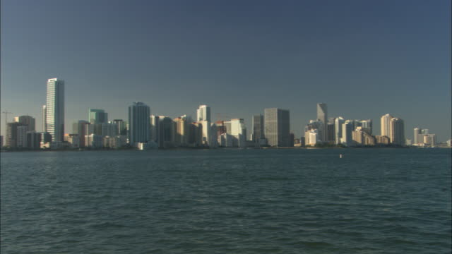 ws pan view across biscayne bay to miami skyline with catamaran /  miami, florida, usa - biscayne bay stock videos and b-roll footage