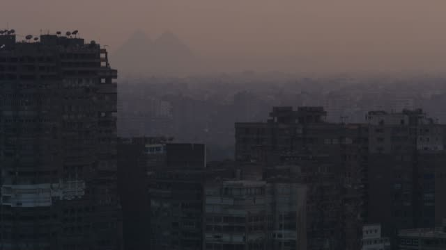 a view across central cairo to the pyramids - cairo stock videos & royalty-free footage