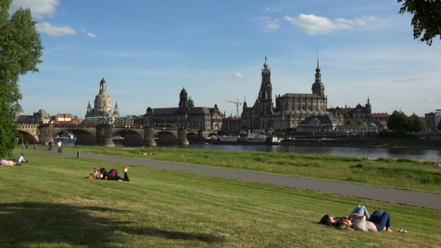 view across elbe river towards bruehl's terrace with frauenkirche, dresden, germany - dresden frauenkirche stock videos & royalty-free footage