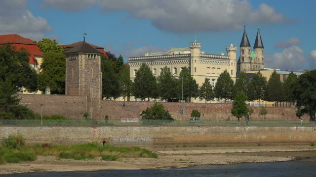 View across Elbe River towards old City Wall and Monastery of Our Lady, Magdeburg, Saxony-Anhalt, Germany