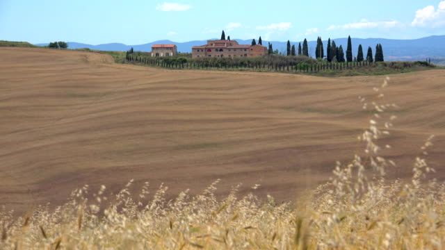 View across Fields with Country House, Landscape of Crete Senesi, Province of Siena, Tuscany, Italy