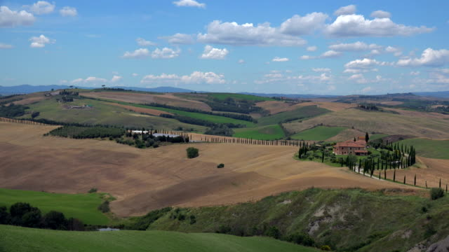 view across fields with country house, landscape of crete senesi, province of siena, tuscany, italy - tuscany stock videos & royalty-free footage