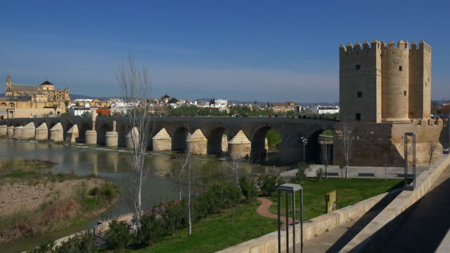 view across guadalquivir river towards mezquita cathedral in cordoba, andalusia1 - mesquita stock videos & royalty-free footage