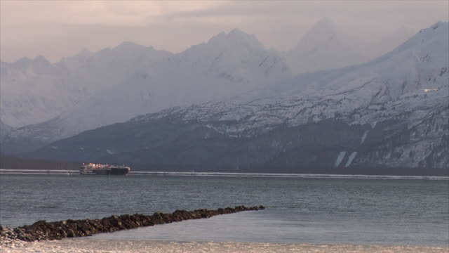 View across harbour to oil tanker and mountains