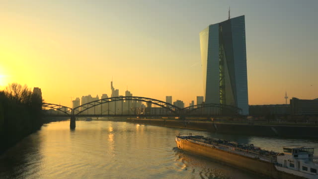 view across main river with building of the european central bank and skyline of frankfurt am main, hesse, germany - エスタブリッシングショット点の映像素材/bロール