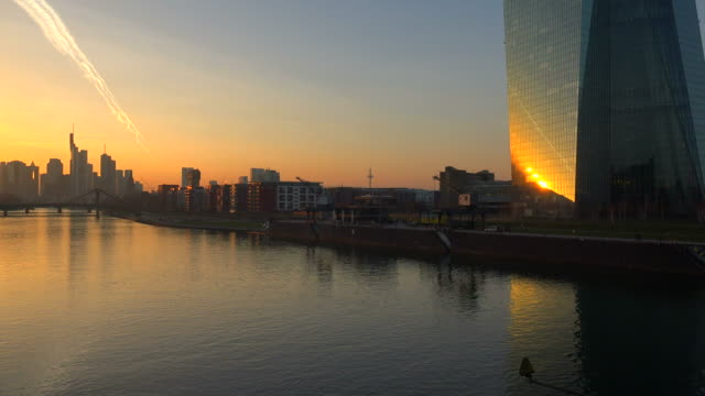 View across Main River with Building of the European Central Bank and Skyline of Frankfurt am Main, Hesse, Germany