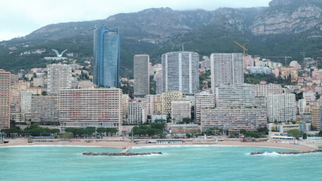 view across monte carlo beach, monaco aerial view - bay of water stock-videos und b-roll-filmmaterial