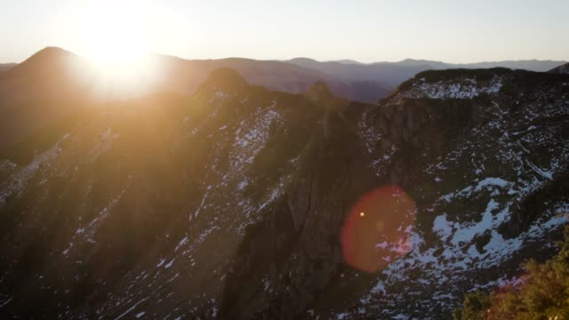 View across mountain ranges at sunrise