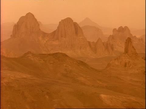 WA View across rocky outcrops in Sahara desert, Hazy, Algeria, Africa