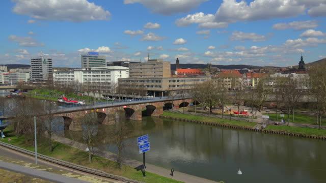View across Saar river and Old Saar Bridge to the city centre ofd Saarbruecken, Saarland, Germany