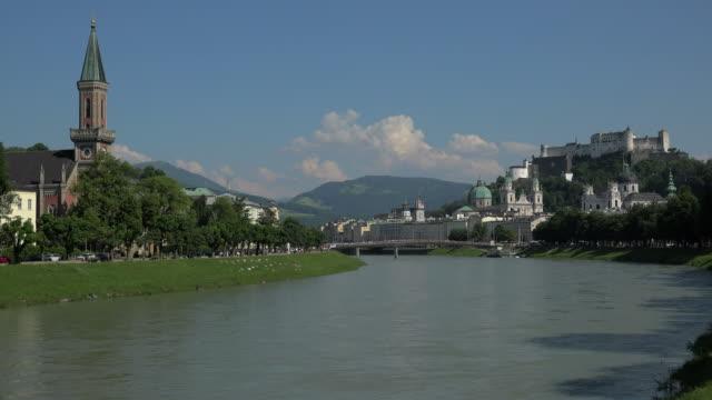 View across Salzach River with Salzburg Cathedral, Collegiate Church and Fortress Hohensalzburg, Salzburg, Austria